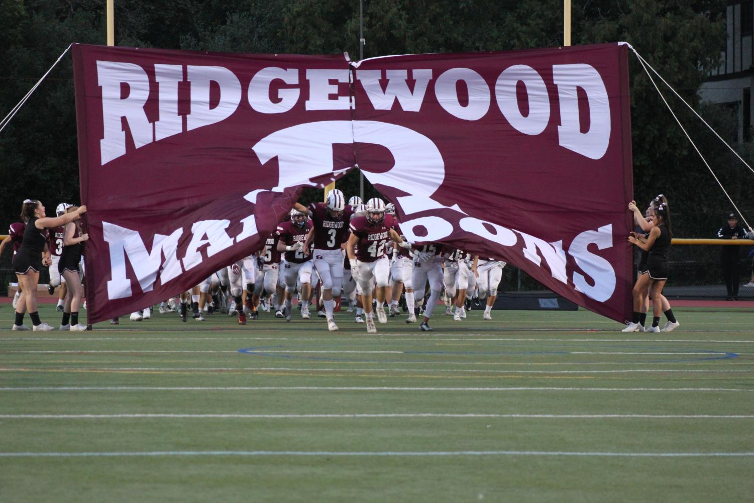 The Maroons take the field.