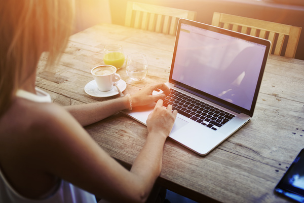 Coffee-on-the-desktop-with-people-using-the-computer-Stock-Photo-05